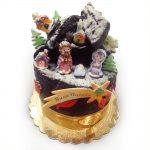 Panettone rivestito di cioccolato con presepe